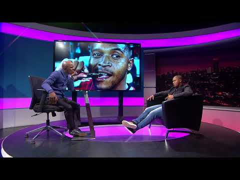 Thomas Mlambo chats to footballer Thandani Ntshumayelo
