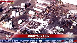 JUNKYARD FIRE: Fire crews battle heat and blaze in Phoenix, AZ