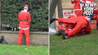 Baixar London's SantaCon has drunk Bad Santas brawling and peeing in public | New York Post