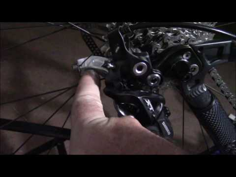 bc404e00631 Shimano XT rear derailleur hack ( using a 10 speed rear derailleur with 9  speed shifters and casset) - YouTube