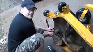 EASY! remove/replace hustler lawnmower deck & blades