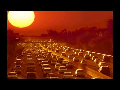 Eclipse Watch; Aerial footage from a helicopter of thousands of parked cars.