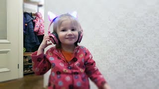 Baby opening surprises on Christmas Funny Cats Headphones