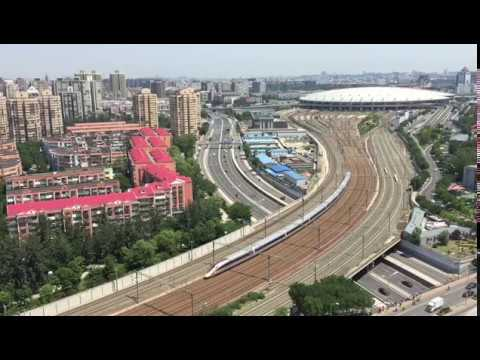 Bird's-eye view: China's new bullet train leaving railway station in Beijing