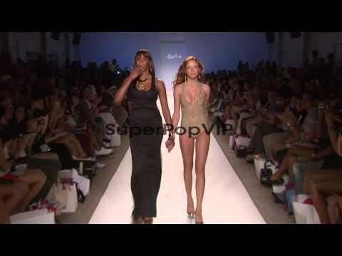 Designer Veronique de la Cruz and model walk runway d