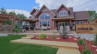 Luxury and country in one...Lively home on 5 acres