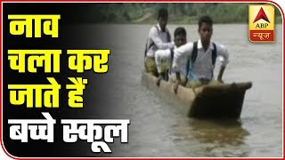 School kids cross overflowing Narmada river in temporary boats