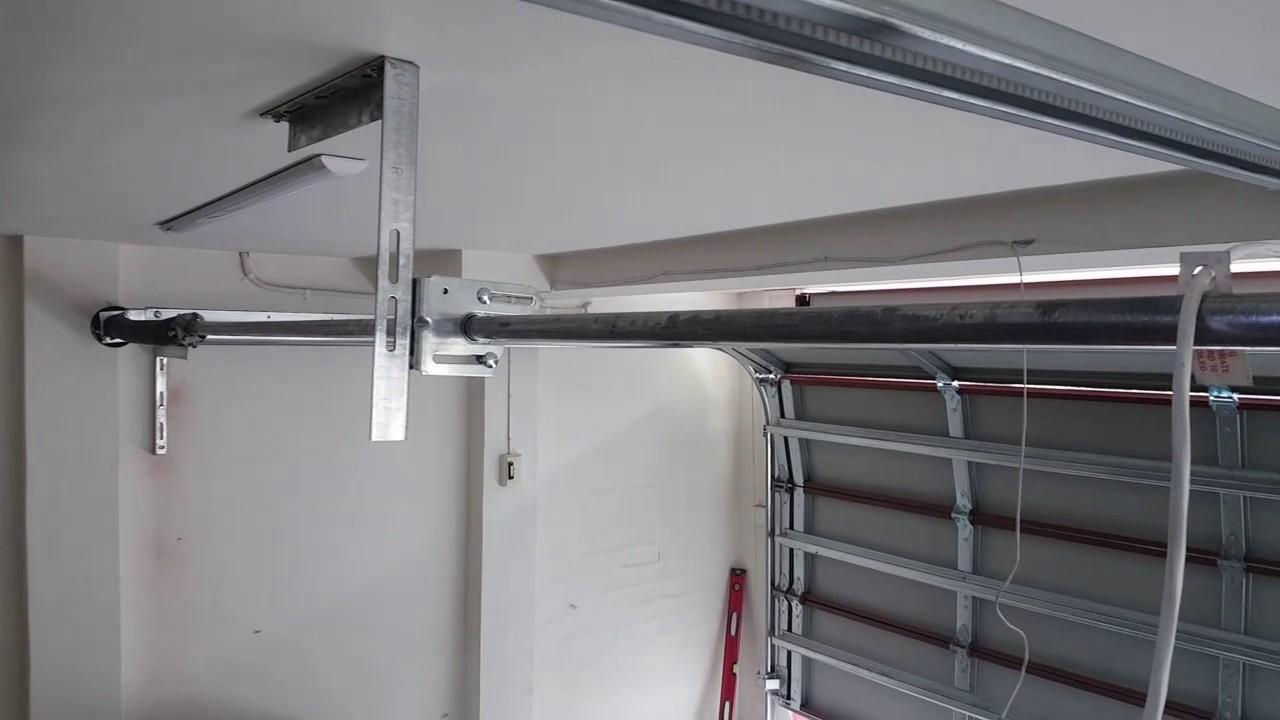 Ordinaire Low Headroom Rear Sprung Sectional Garage Door.