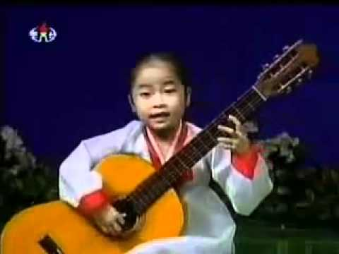Little North Korean Girl Playing Guitar...