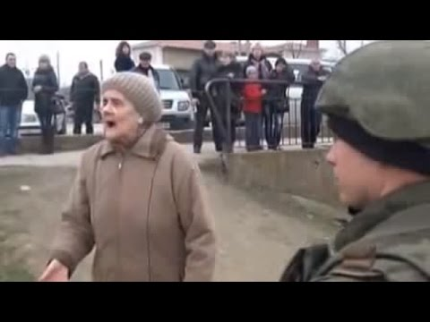 Ukraine War - Old lady protests against Russian intervention into Crimea Ukraine