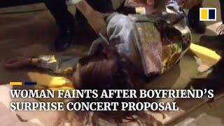 Woman in China faints after boyfriend's surprise concert proposal