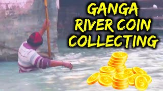 Ganga River Flowing in Haridwar - Man Collecting Coins by Magnet Stick in Cold Water
