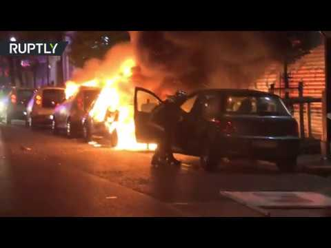 Paris protests end in flames as youths set cars on fire