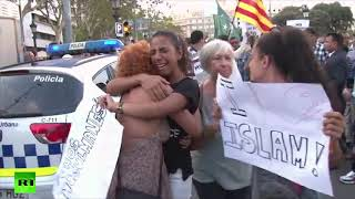Tears as Muslims condemn attacks at Las Ramblas rally