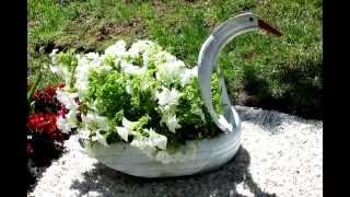 Лебедь из покрышки своими руками(Как сделать лебедя своими руками из старых шин покрышек., 2014-05-20T11:21:57.000Z)
