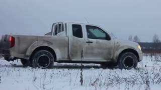 Nissan Frontier Navara D40 on snow offroad
