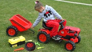 Sofia repairs a broken Toy Tractor with children's tools.
