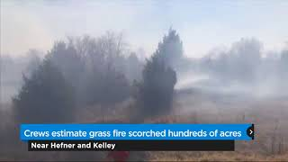 Crews estimate grass fire scorched hundreds of acres