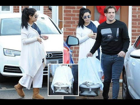 Cara De La Hoyde and Nathan Massey spotted with new baby son just one day after his birth