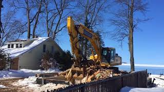 Excavator makes quick work of Oneida Lake house
