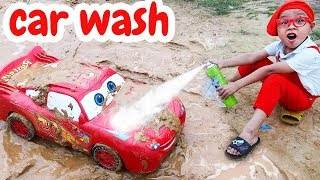Disney Cars Lightning McQueen Toy car wash after jump in mud with Dave Mario and brother