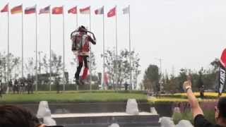 Human flying with jet pack in Beijing