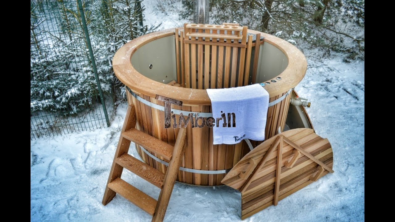 Red cedar wood fired hot tub unique model timberin for Outdoor bathtub wood fired