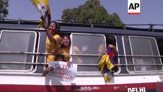 Scuffles and arrests as Tibetan women try to reach China embassy