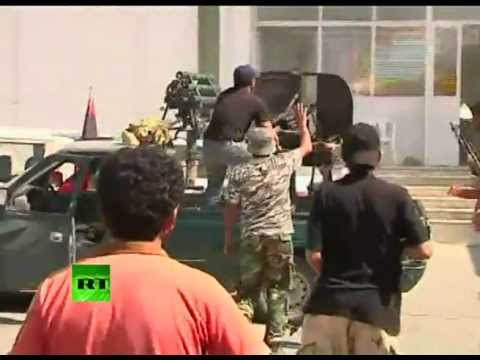 Video of Tripoli fighting, smoke over capital as Libya rebels rule streets
