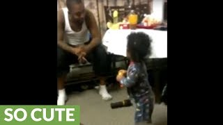 Baby gets into heated debate with daddy
