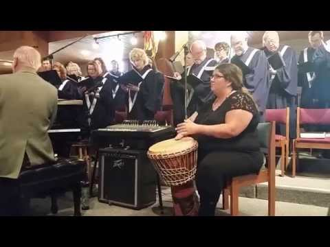 Trisha drums in a performance with the St. Lucy Catholic Church choir