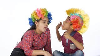 Young brother and sister teasing each other while wearing fancy wigs - a joyful moment