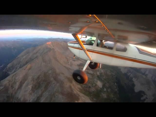 Daybreak - Cessna 180 over the Colorado Rockies