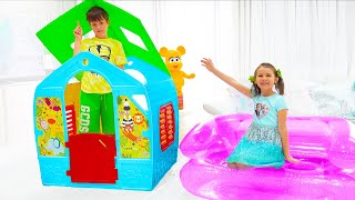 Katy and Max find Surprises in their playhouse