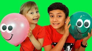 Alena and Pasha plays with balloons in school