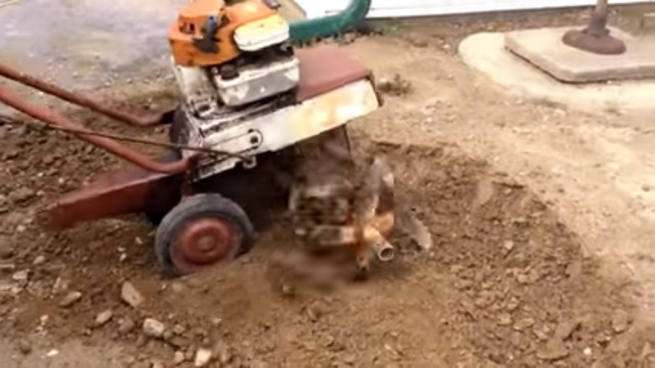 1973 Briggs and Stratton 3.5 hp rototiller working up hard soil with ...