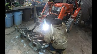 Welding a grapple bucket