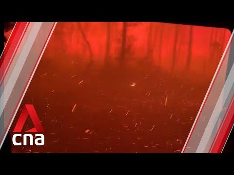 Bushfire Overruns Firefighters' Truck In Australia