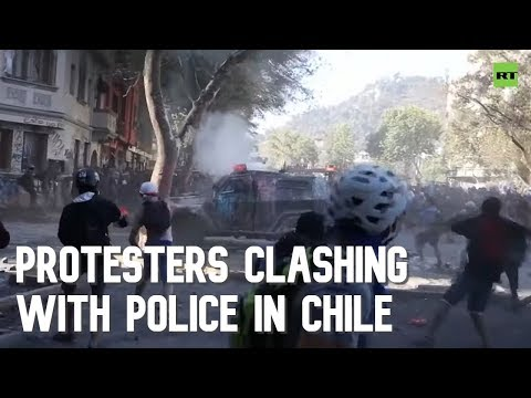 Masked protesters clash with police in Chile