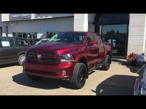 """2017 Red Pearl Ram 1500 Sport with a 4"""" lift"""
