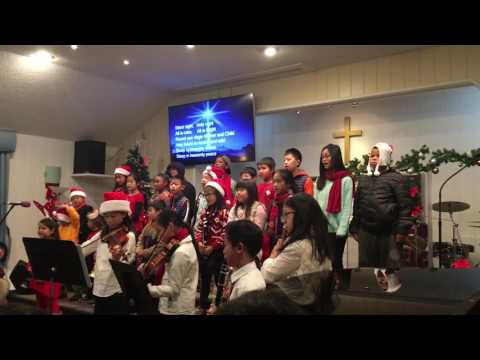 Children's choir and band perform Christmas songs at Church