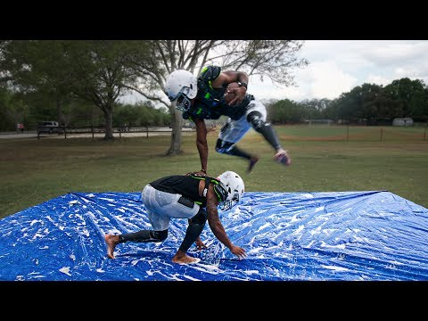 PLAYING TACKLE FOOTBALL ON A SLIP AND SLIDE PT. 2
