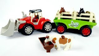 A toy tractor on a farm. Kids' learning videos.