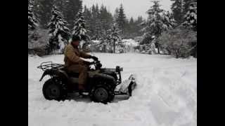 Suzuki king quad plowing snow