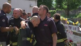 Grenfell Tower fire: Families and firefighters hug remembering victims