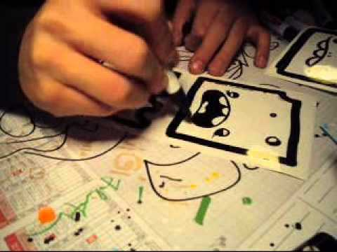 Luigi making streetart stickers