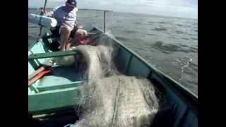 Pescaria com redes no Mar