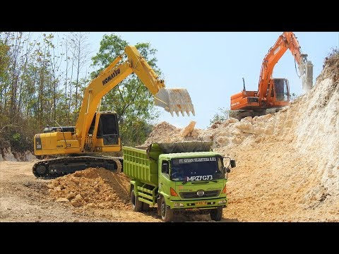 Excavator Dump Truck Digging Limestone On Road Construction Kobelco SK200 Komatsu PC200