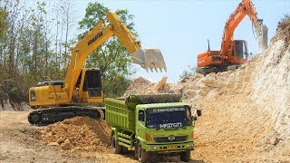 Excavator Dump Truck Digging Limestone On Road Construction Kobelco SK200 Komatsu PC200.mp3