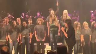 Carter and LRHS acappella singing on stage with Foreigner!